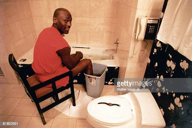 Basketball Casual portrait of Chicago Bulls Michael Jordan in bathroom soaking ankle sprain injury in bathtub Orlando FL 3/1/19933/31/1993