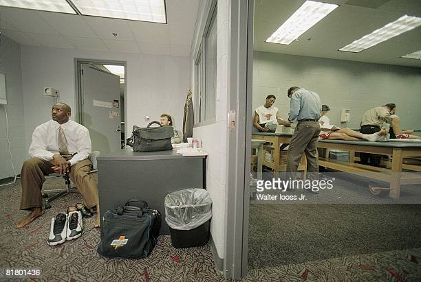 Basketball Casual portrait of Chicago Bulls Michael Jordan in doctor's private office View of Scottie Pippen and Toni Kukoc in trainers room before...