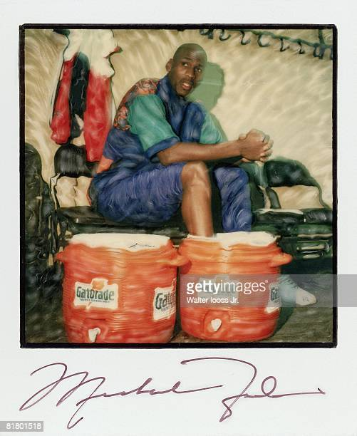 Basketball Casual portrait of Chicago Bulls Michael Jordan with Gatorade water bucket Polaroid with signature Secaucus NJ 1/1/1993