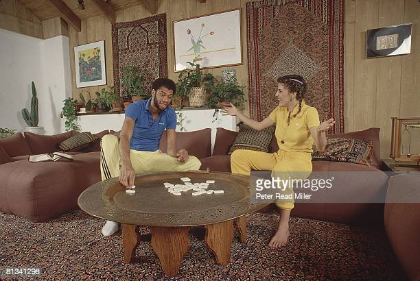 Basketball Casual portrait of Los Angeles Lakers Kareem AbdulJabbar with girlfriend Cheryl Pistono at his home in BelAir Los Angeles CA 3/8/1980