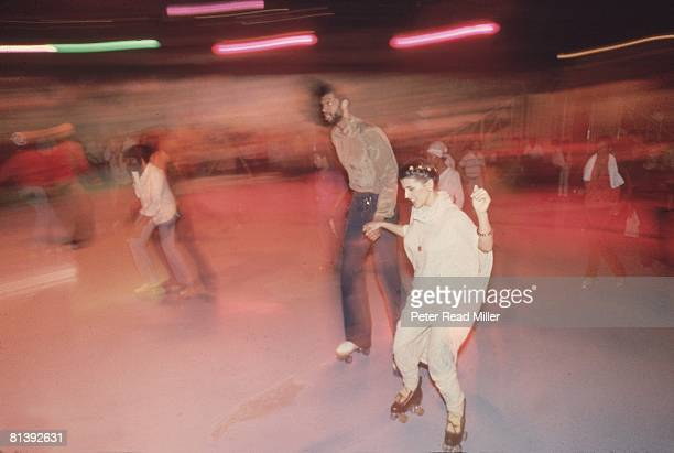 Basketball Casual portrait of Los Angeles Lakers Kareem AbdulJabbar roller skating with girlfriend Cheryl Pistono at Flipper's Roller Boogie Palace...
