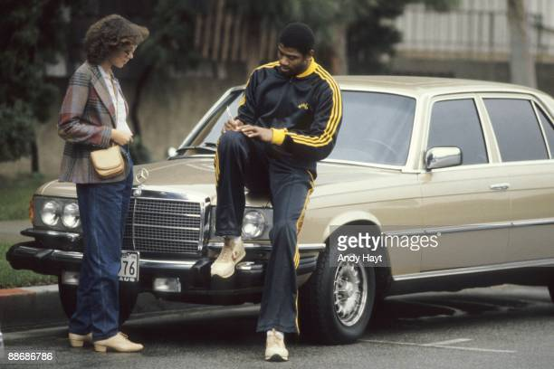 Casual portrait of Los Angeles Lakers Magic Johnson signing autograph for fan Johnson's return to NBA after sustaining torn cartilage injury in left...