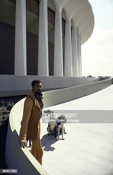 Casual portrait of Los Angeles Lakers Wilt Chamberlain with his dogs outside of The Forum Inglewood CA CREDIT Stephen GreenArmytage