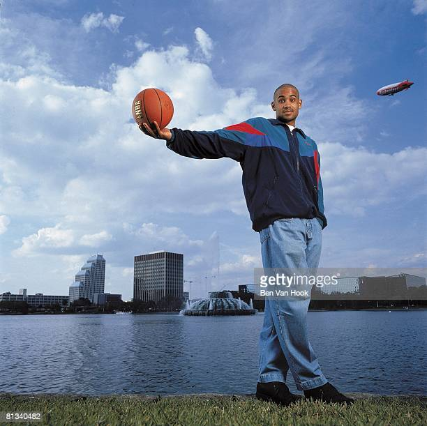 Basketball Casual portrait of Orlando Magic Grant Hill with ball equipment Scenic view of Orlando skyline Orlando FL 7/1/2000