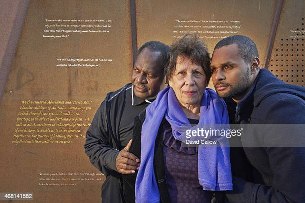 Casual portrait of San Antonio Spurs point guard Patty Mills with his mother Yvonne and father Benny during photo shoot in front of Stolen Generation...