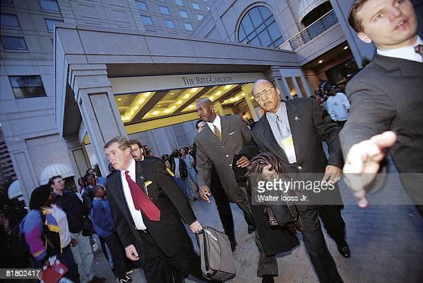 Basketball Casual view of Chicago Bulls Michael Jordan leaving Ritz Carlton Hotel with bodyguard and friend Gus Lett before game vs Washington...
