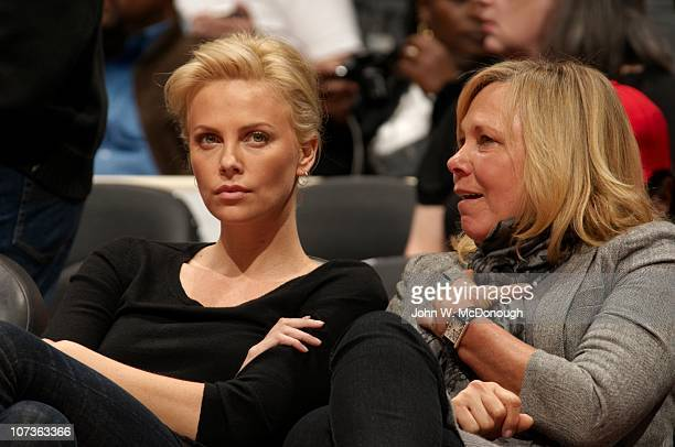 Celebrity actress Charlize Theron with mother Gerda sitting courtside during Los Angeles Clippers vs New Orleans Hornets game at Staples CenterLos...
