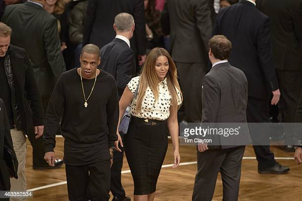 Celebrity rapper JayZ and his wife singer Beyonce on court before Cleveland Cavaliers vs Brooklyn Nets game at Barclays Center Brooklyn NY CREDIT Tim...