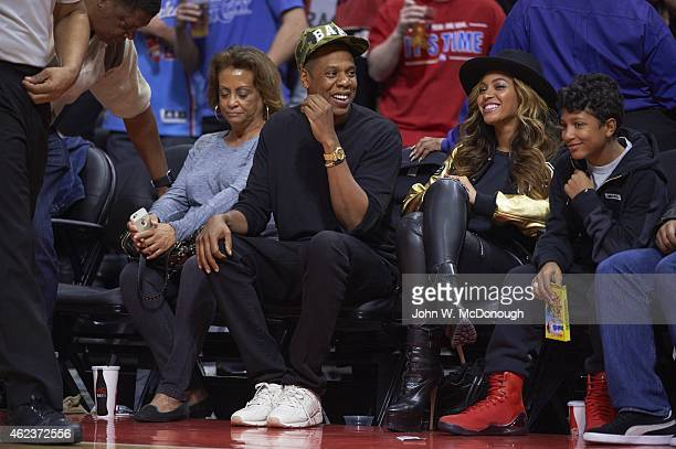 Celebrity rapper JayZ with wife Beyonce sitting courtside during Los Angeles Clippers vs Cleveland Cavaliers game at Staples Center Los Angeles CA...