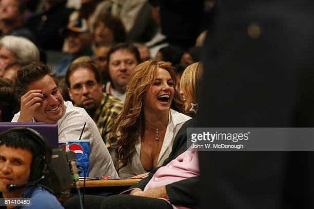 Basketball Celebrity singer and performer Britney Spears with sister Jamie Lynn Spears and William Morris agent Jason Trawlick during Washington...