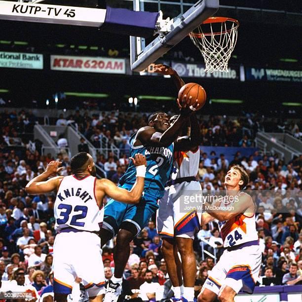 Charlotte Hornets Larry Johnson in action layup vs Phoenix Suns at America West Arena Phoenix AZ CREDIT John W McDonough