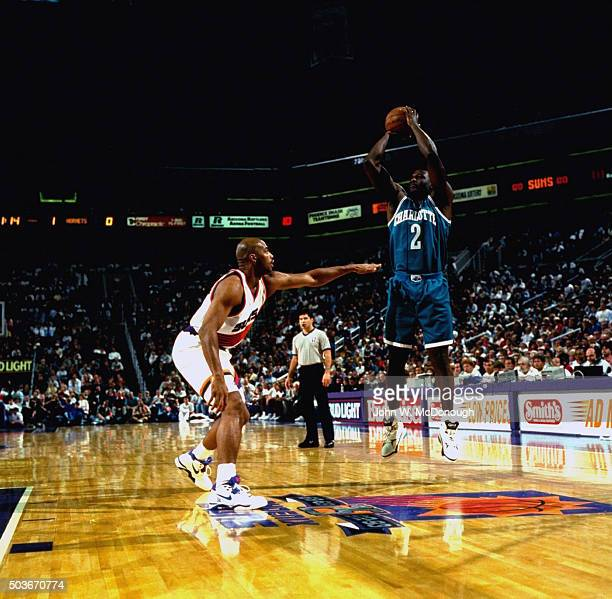 Charlotte Hornets Larry Johnson in action shot vs Phoenix Suns Charles Barkley at America West Arena Phoenix AZ CREDIT John W McDonough