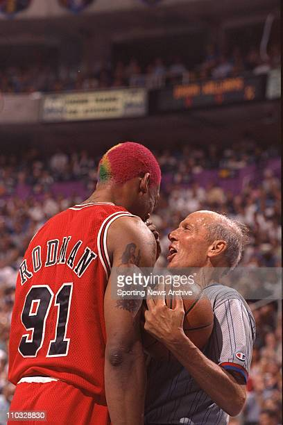 NBA Basketball Chicago Bulls Dennis Rodman talks with an official in Game 4 of the NBA Finals against the Utah Jazz on June 8 at Delta Center in Salt...