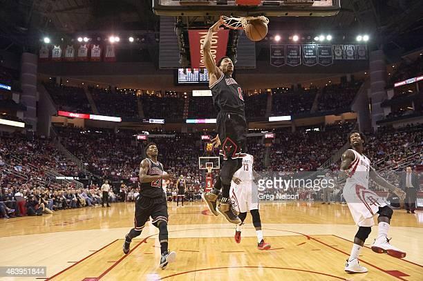 Chicago Bulls Derrick Rose in action dunking vs Houston Rockets at Toyota Center Houston TX CREDIT Greg Nelson