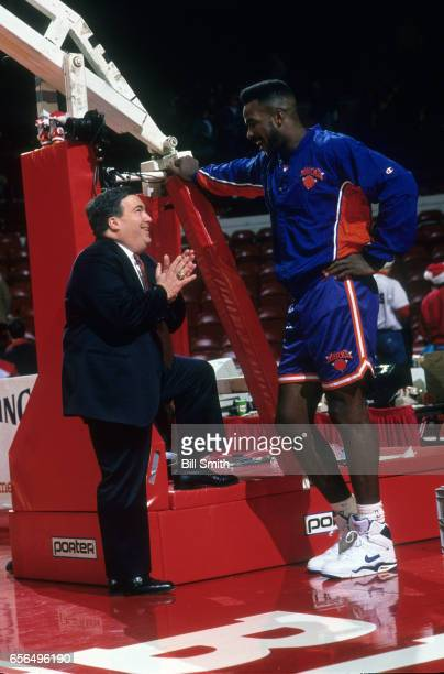 Chicago Bulls general manager Jerry Krause talking to New York Knicks Charles Oakley on court before game at the United Center Chicago IL CREDIT Bill...