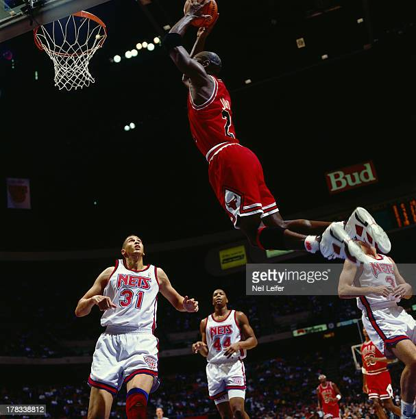 Chicago Bulls Michael Jordan in action dunk vs New Jersey Nets at Brendan Byrne Arena East Rutherford NJ CREDIT Neil Leifer