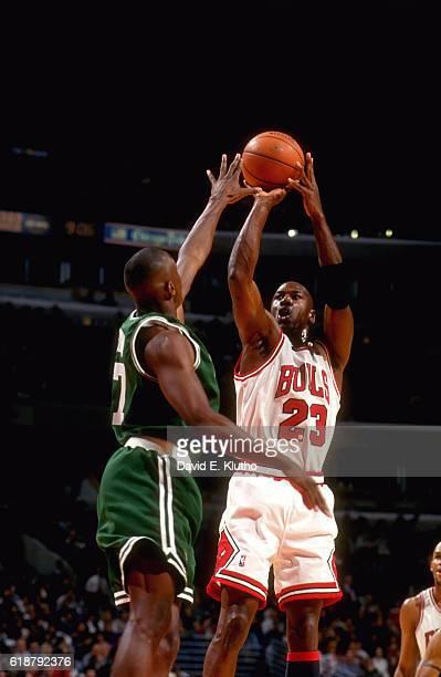 Chicago Bulls Michael Jordan in action shooting vs Boston Celtics Dana Barros at United Center Chicago IL CREDIT David E Klutho