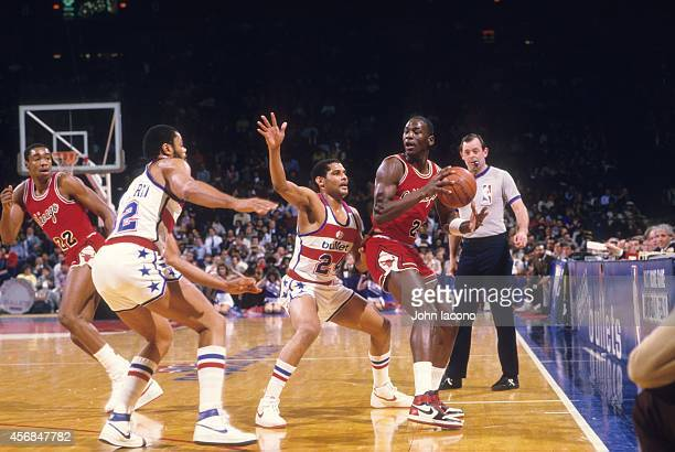 Chicago Bulls Michael Jordan in action vs Washington Bullets Jeff Malone at Capital Centre Jordan wearing red Nike Air Jordan 1 sneakers Landover MD...