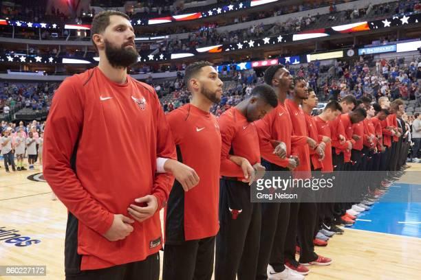 Chicago Bulls players locking arms during anthem before preseason game vs Dallas Mavericks at American Airlines Center. Dallas, TX 10/4/2017 CREDIT:...