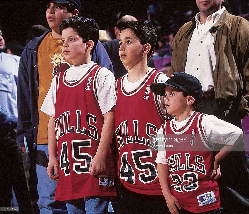 best sneakers 31df9 62a64 Chicago Bulls youth fans with Michael Jordan jersey during ...