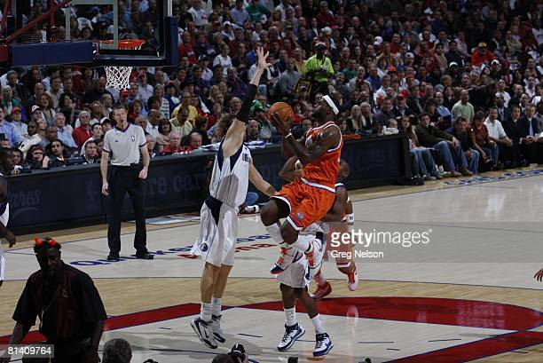 Basketball Cleveland Cavaliers LeBron James in action layup vs Dallas Mavericks Dirk Nowitzki Cleveland OH