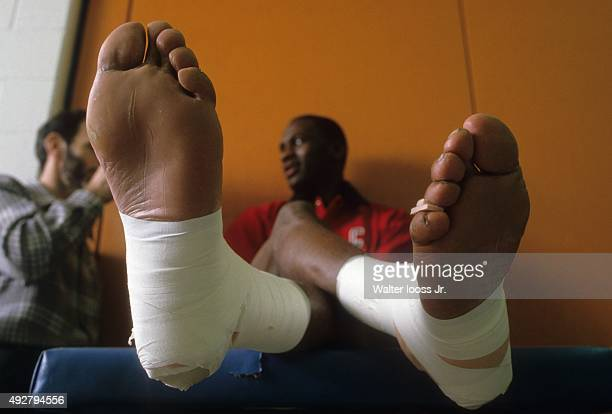 Closeup of feet of Chicago Bulls Michael Jordan as he sits on trainer's table before game vs Detroit Pistons at Pontiac Silverdome Pontiac MI CREDIT...