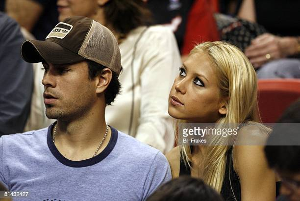 Basketball Closeup of former tennis player Anna Kournikova and celebrity performer Enrique Iglesias during Cleveland Cavaliers vs Miami Heat game...