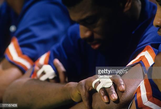 Closeup of New York Knicks Bernard King on bench during Game 5 vs Boston Celtics at Boston Garden View of injured fingers taped togetherBoston MA...