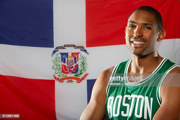 Closeup portrait of Boston Celtics Al Horford posing in front of the national flag of Dominican Republic during photo shoot at The Sports Authority...