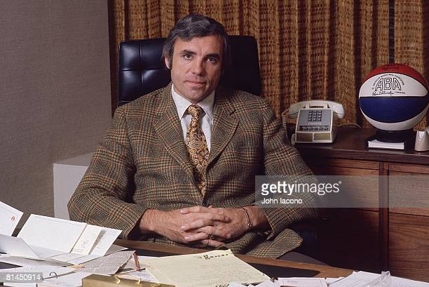 Closeup portrait of commissioner Dave DeBusschere at desk in office New York NY 12/4/1975