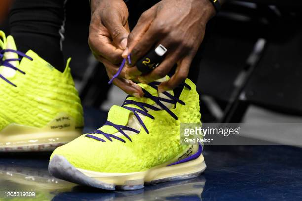 Closeup view of Los Angeles Lakers LeBron James' sneakers being tied and with the names of his sons Bronny Bryce daughter Zhuri and his wife Savannah...