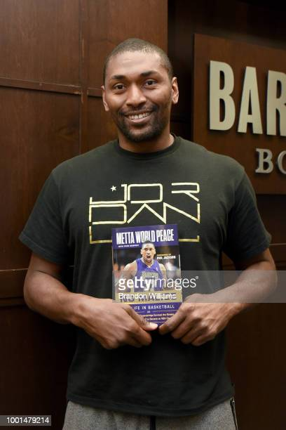 Basketball coach / former professional basketball player Metta World Peace signs copies and celebrates his memoir 'No Malice' at Barnes Noble at The...