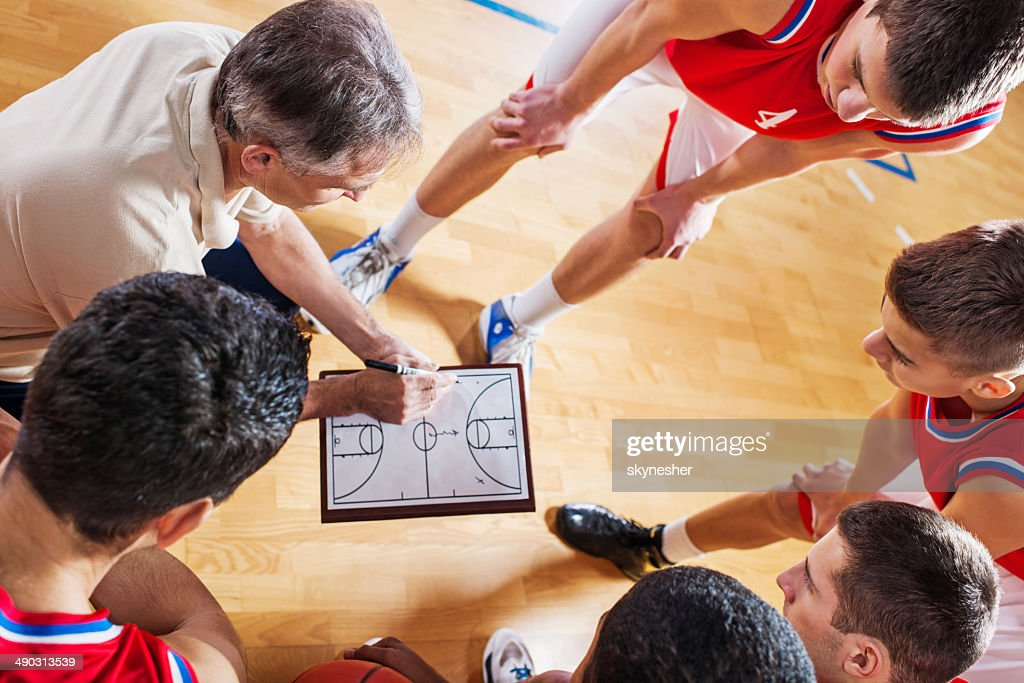 Basketball coach with his team. : Stock Photo
