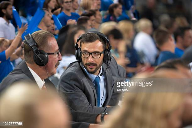 basketball commentators looking at each other - commentator stock pictures, royalty-free photos & images