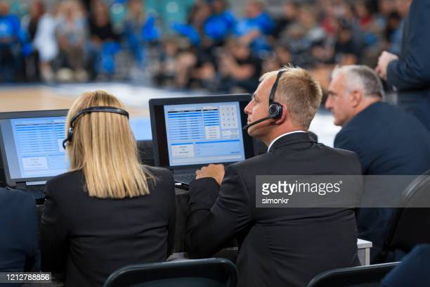 basketball commentators using laptops - commentator stock pictures, royalty-free photos & images