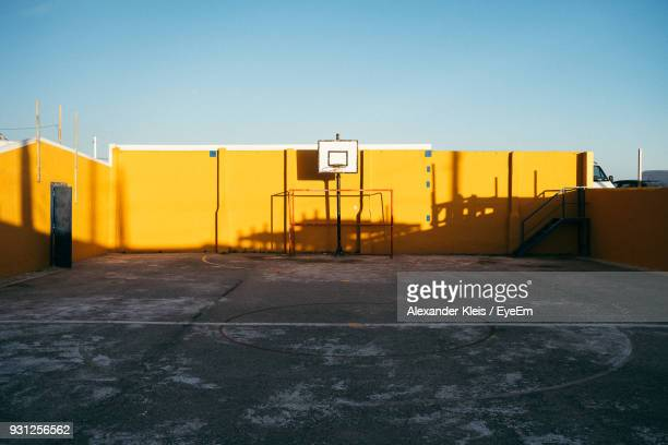 basketball court against clear sky - courtyard stock photos and pictures