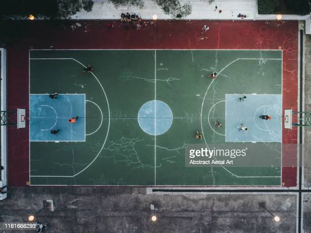 basketball court and players taken by drone, hong kong - match sport stock pictures, royalty-free photos & images
