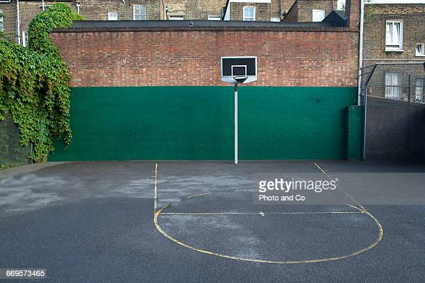 basketball court in the city - britain playgrounds stock pictures, royalty-free photos & images