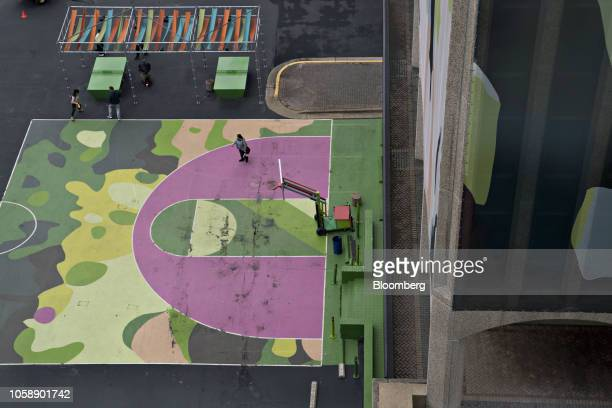 A basketball court sits outside the 1851 S Bell Street building left in the Crystal City area of Arlington Virginia US on Wednesday Nov 7 2018...