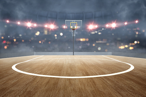 Basketball court with wooden floor and spotlights 1170814984
