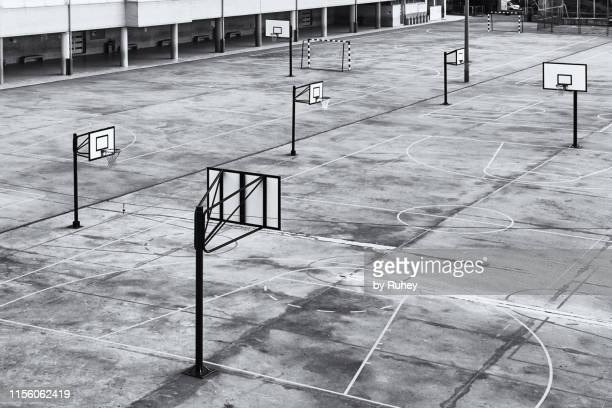 basketball courts in a schoolyard - 中庭 ストックフォトと画像