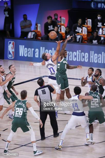 Dallas Mavericks Luka Doncic in action, jumpball vs Milwaukee Bucks Eric Bledsoe at AdventHealth Arena. Orlando, FL 8/8/2020 CREDIT: David E. Klutho