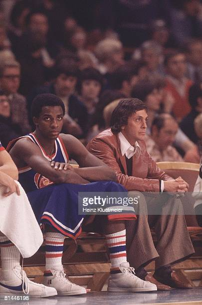 Basketball Denver Nuggets David Thompson and coach Larry Brown on sidelines bench during game vs Milwaukee Bucks Milwaukee WI 11/6/1976