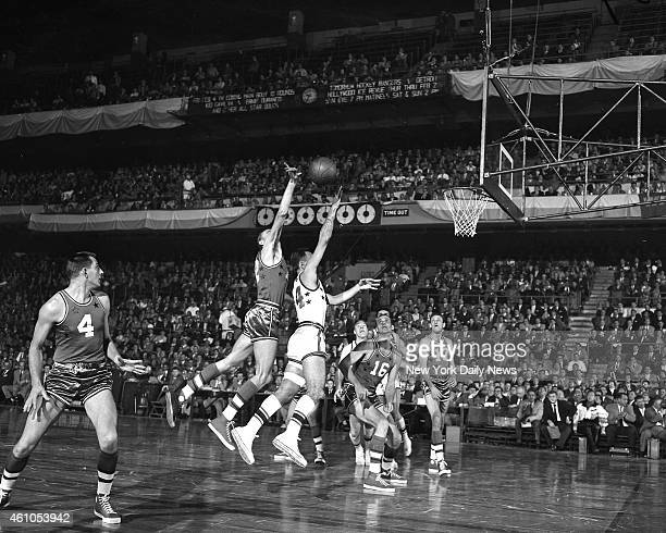 NBA Basketball East vs West Tandem Shot Looks as if the East's Bob Cousy and the West's George Yardley teamed up to push ball basketward in the pro...