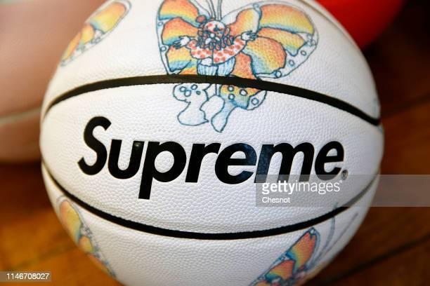 A basketball entitled Crazy butterfly by Spalding X Supreme is displayed during the exhibition Don't believe the Hype at Artcurial auction house on...