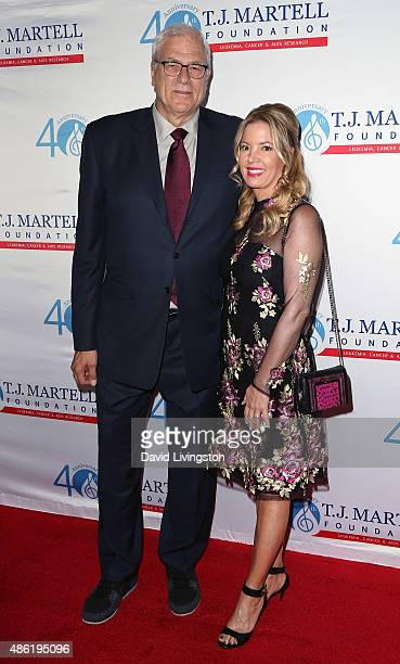 Basketball executive Phil Jackson and Los Angeles Lakers president Jeanie Buss attend the TJ Martell Foundation's Spirit of Excellence Awards at the...