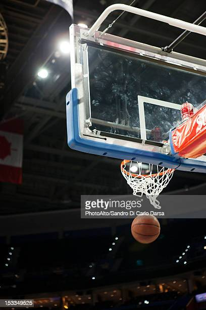 basketball falling through hoop - shooting baskets stock photos and pictures