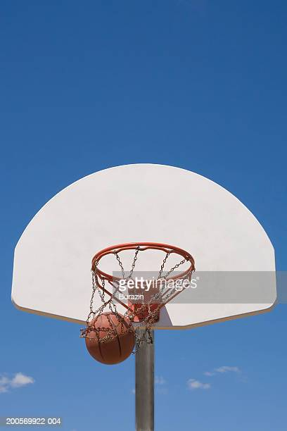 basketball falling through hoop - basketball hoop stock pictures, royalty-free photos & images