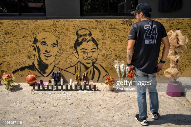 A basketball fan looks on at a mural of former NBA star Kobe Bryant and his daughter Gianna outside the House of Kobe basketball court on January 28...