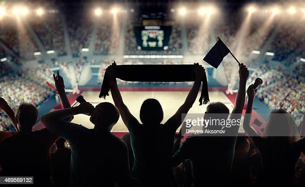 basketball fans at basketball arena - fan enthusiast stock pictures, royalty-free photos & images